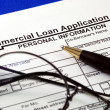 File the commercial loan application isolated on blue - Stock Photo