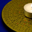 Chinese Feng Shui compass with the candle isolated on blue — Stock Photo #3728723