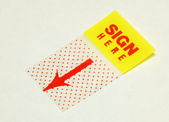 Close up view of the sign here sticker — Stock Photo