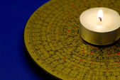 Chinese Feng Shui compass with the candle isolated on blue — Stock Photo