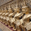 Royalty-Free Stock Photo: Golden figures warrior in royal palace