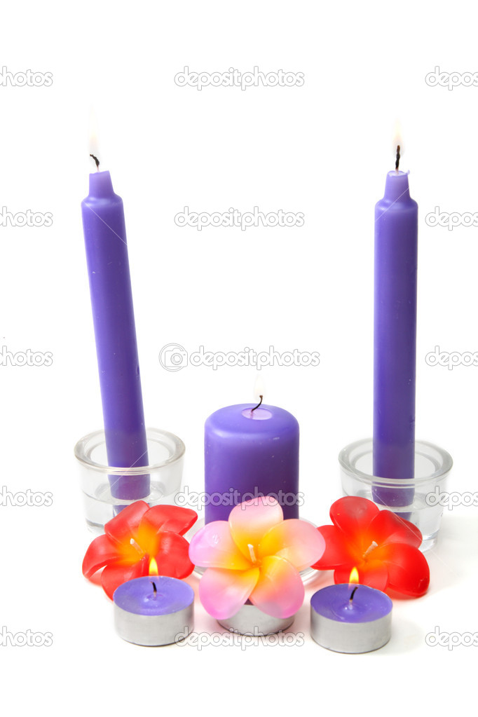 Violet candles in glass candlestick and in the manner of waxy colour blaze on white background — Photo #2853894