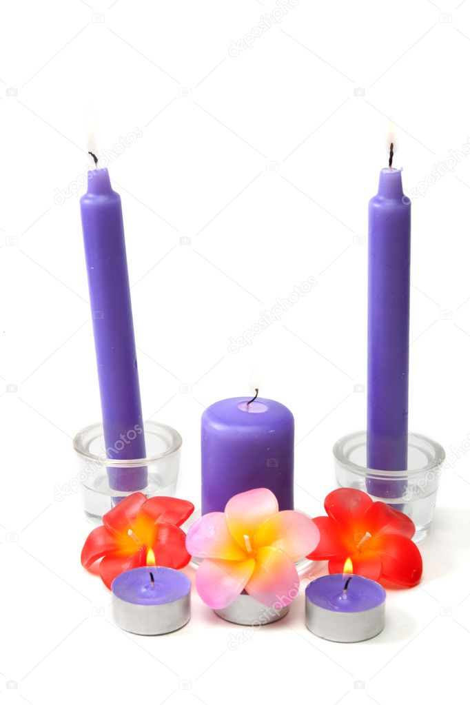 Violet candles in glass candlestick and in the manner of waxy colour blaze on white background  Foto Stock #2853894
