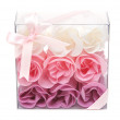 Royalty-Free Stock Photo: Fabrics rose in transparent gift to box