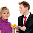 Man in suit presents daisywheel to woman — Stock Photo