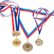 Three medals for first place with tape — Stock Photo