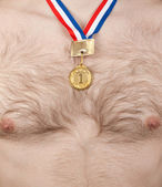 Nude male thorax with golden medal — Stock Photo