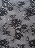 Black lace with pattern from flower — Stock Photo