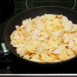 Fried potatoes in pan — Stock Photo