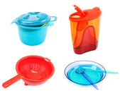 Collage plastic dishes on white background — Stock Photo