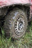 Muddy car tire — Stock Photo