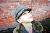 A boy is in the clothes of the forties — Stock Photo
