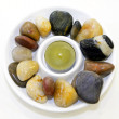 Candle and stones — Stock Photo