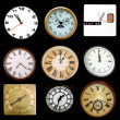 Stock Photo: Clocks on black