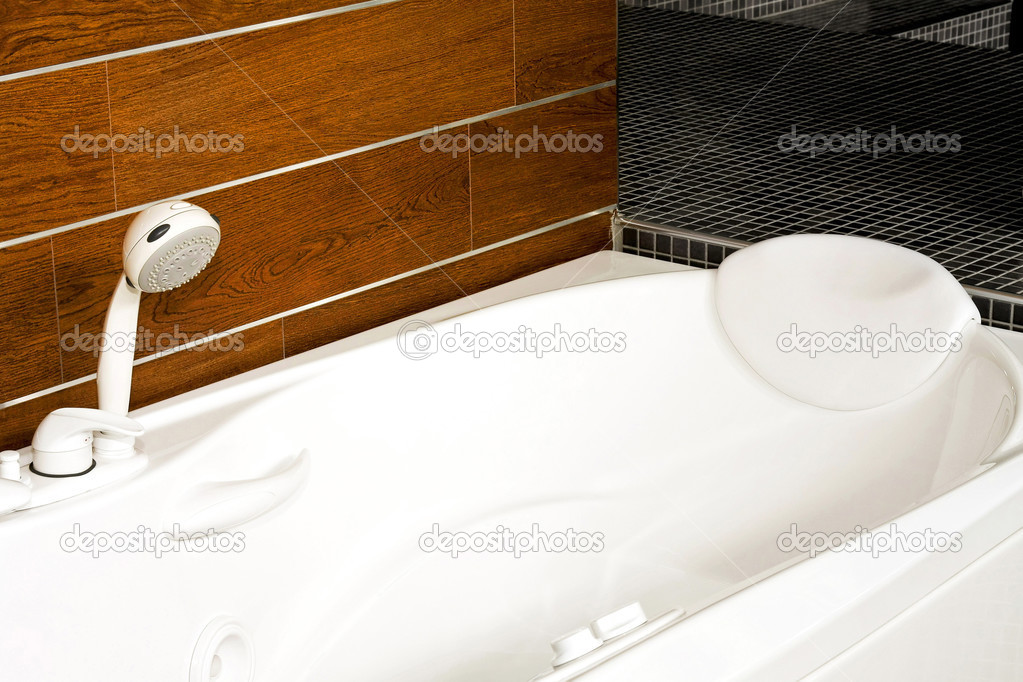 Big modern bathtub with wooden background wall  Stock Photo #2979517