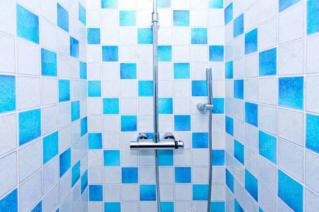 Inside of shower with blue and white tiles — Stock Photo #3037111