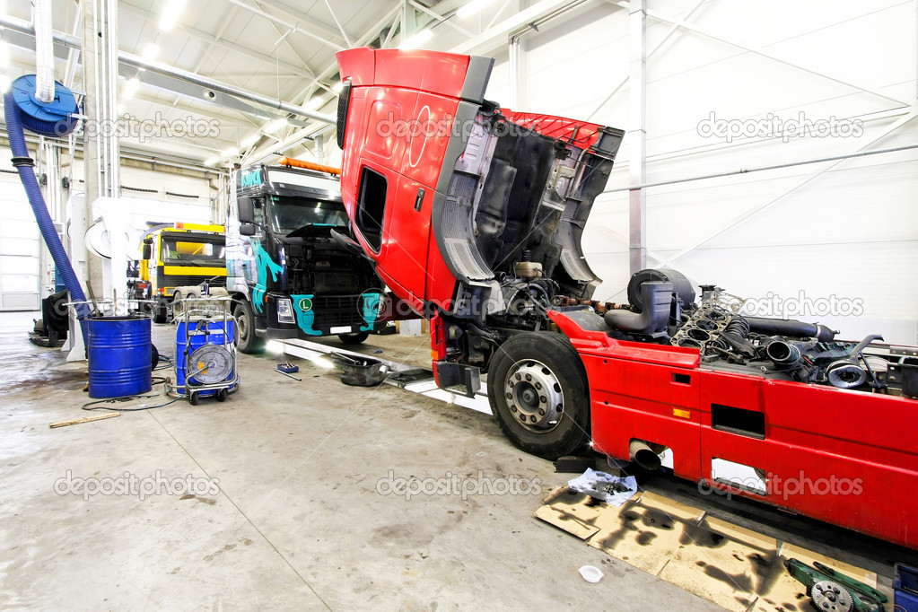 Red open truck in big service garage — Stock Photo #3037798