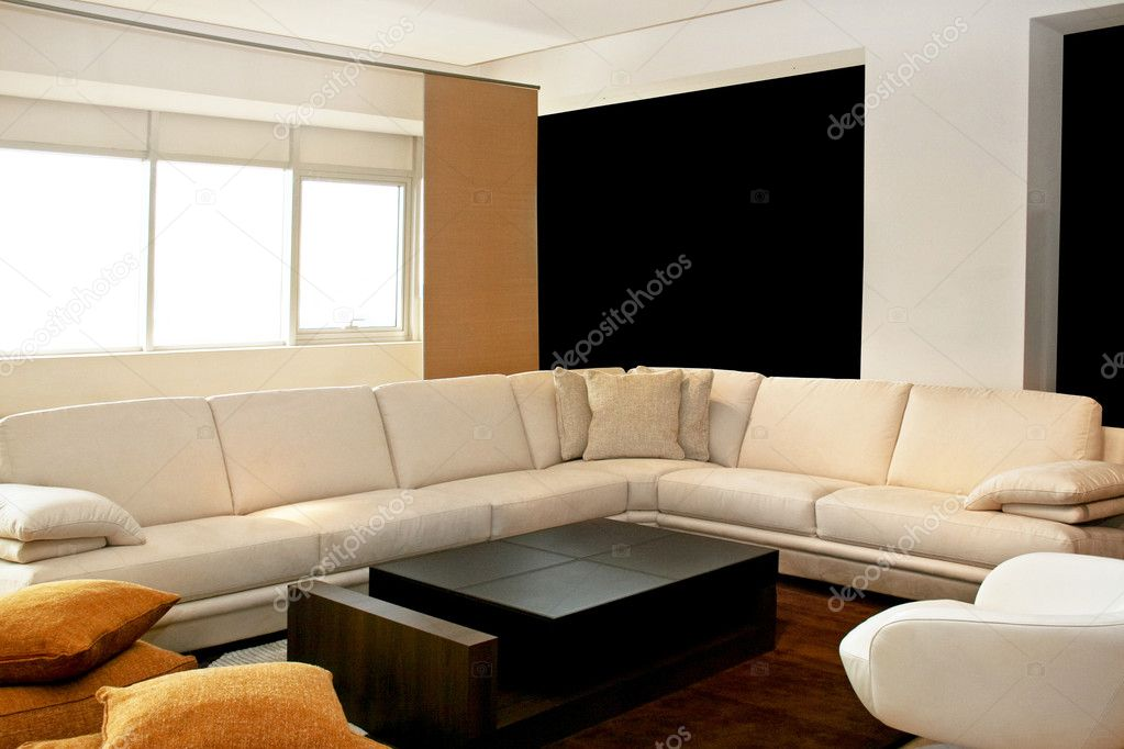 Living room with big sitting area in leather — Stock Photo #3171948