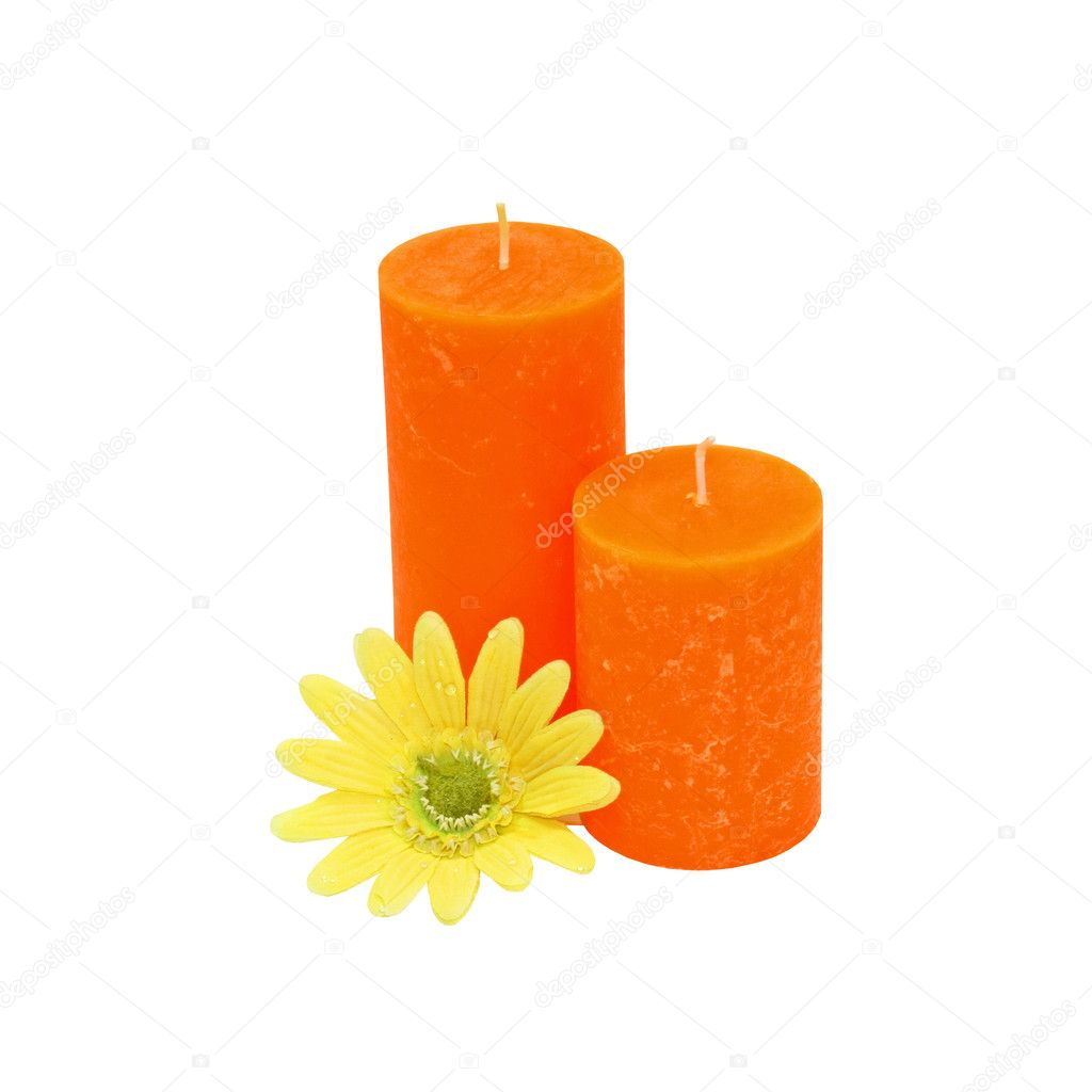 Two orange candles and yellow flower isolated — Stock fotografie #3199832