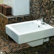 Stock Photo: Bidet and tiles