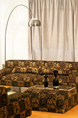 Golden settee — Stock Photo