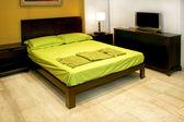 Green double bed — Stock Photo