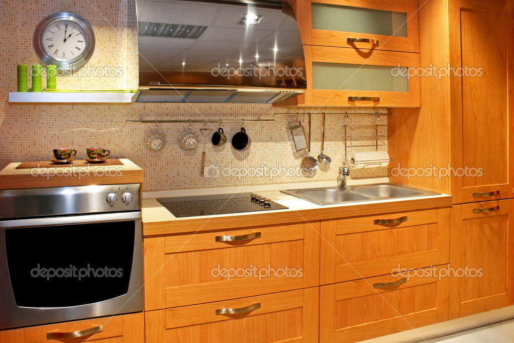 Modern wooden kitchen counter in new apartment  Stock Photo #3291379