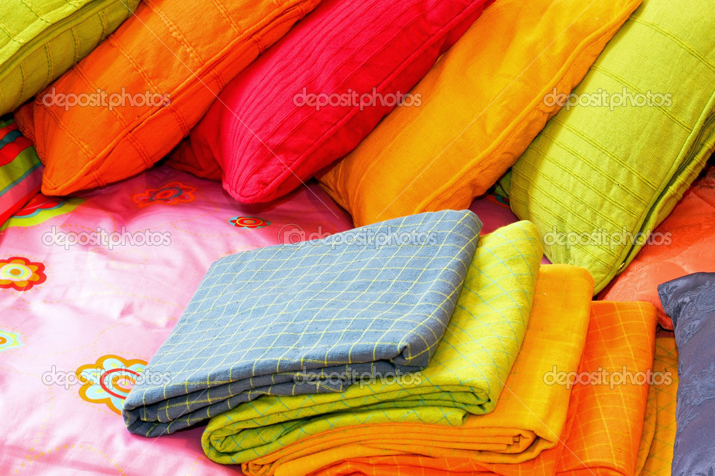 Bunch of colorful pillows and blankets for bed — Stock Photo #3373676