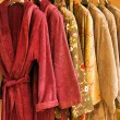 Several soft and warn bathrobe in closet — Stock Photo #3466070