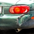 Stock Photo: Crashed car bumper