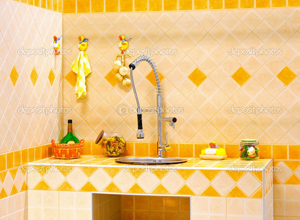 Kitchen counter and sink with orange tiles — Stock Photo #3462320