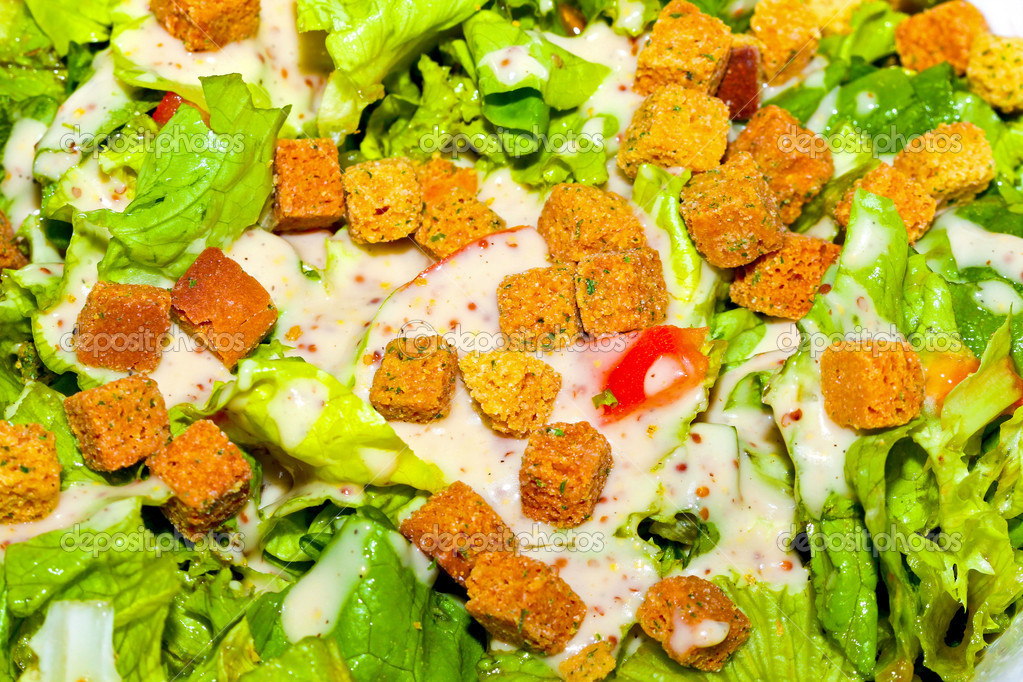 Organic fresh salad with croutons and dressing — Stock Photo #3489201