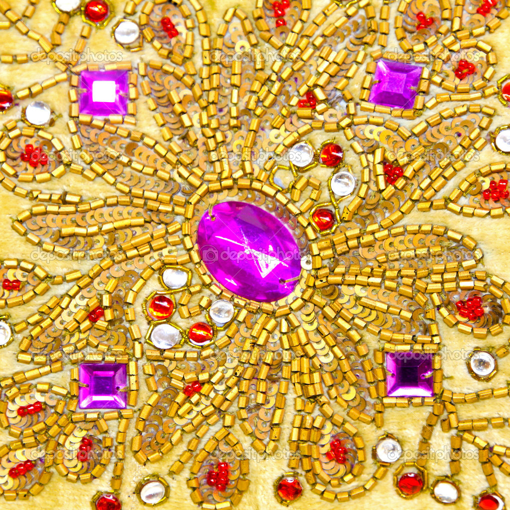 Detail of sparkling jewels with gold ornaments — Stock Photo #3510266