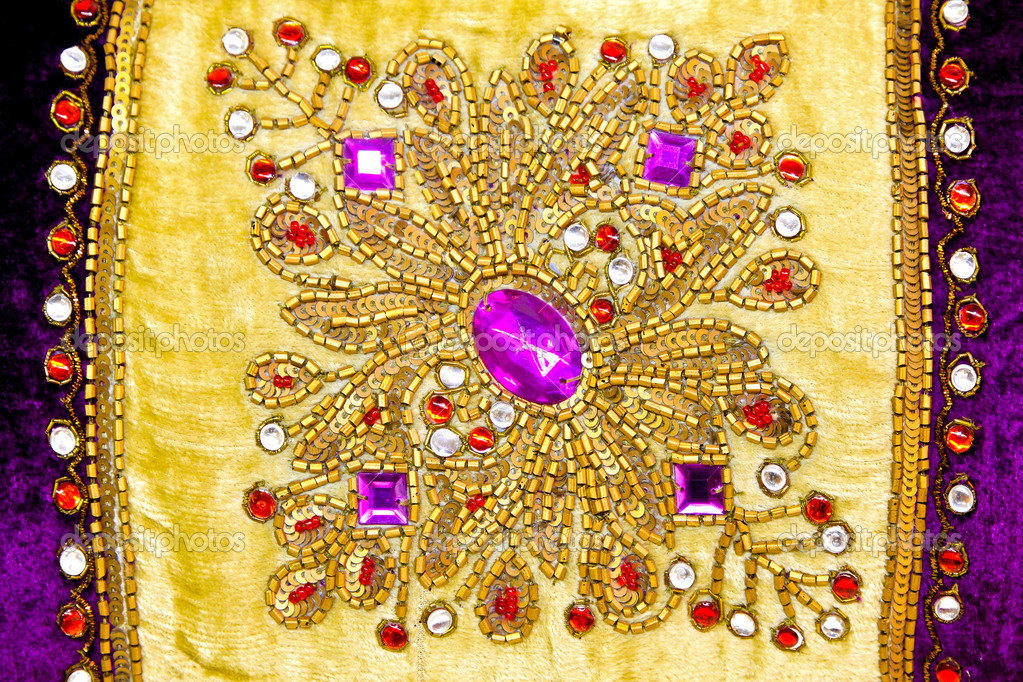 Detail of sparkling jewels with gold ornaments — Stock Photo #3540573