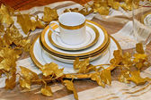 Golden crockery — Stock Photo