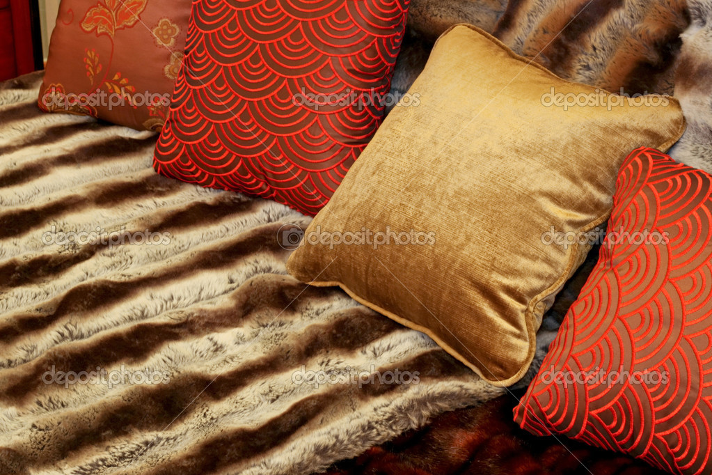 Bunch of pillows and fancy decorative sheets — Stock Photo #3616208