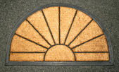 Doormat sun — Stock Photo
