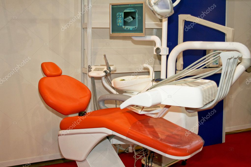 Orange dentist chair with equipment and monitor  — Stock Photo #3625555