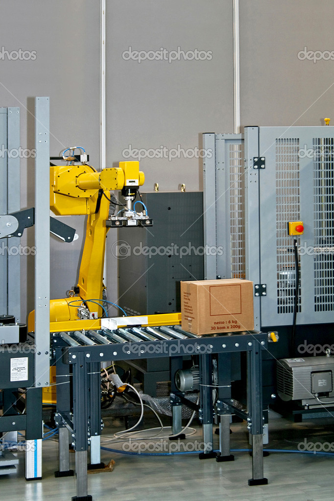 Robotic arm at work in factory packing boxes  Stock Photo #3633726