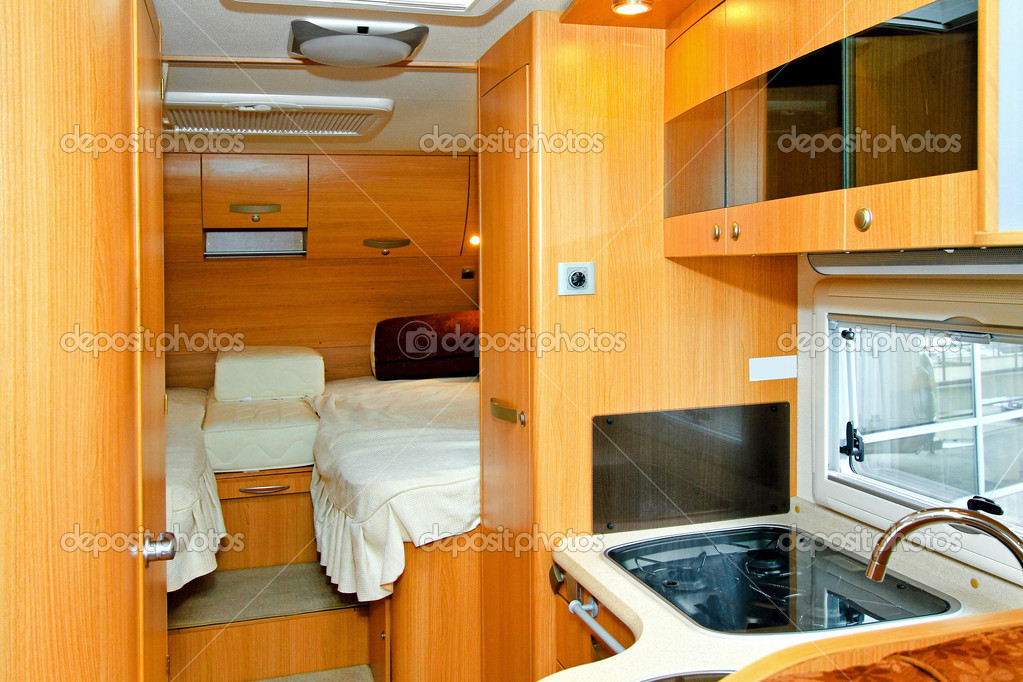 Interior of kitchen and bedroom in recreation vehicle  Stock Photo #3829726