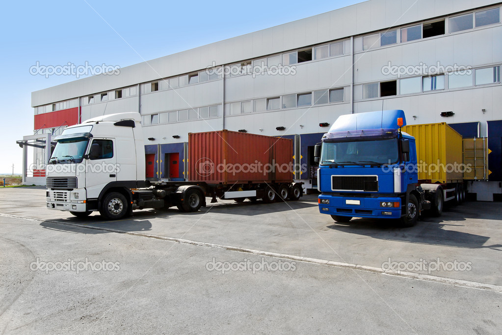 Unloading big container trucks at warehouse building — Stock Photo #3859791