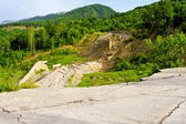 Road mudslide erosion — Stock Photo