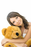 Young woman with toy bear — Stock Photo