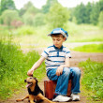 Boy and dog — Stock Photo #3408858