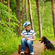 Stock Photo: Boy and dog