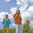 Childrem blowing bubbles — Stock Photo