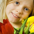 Girl and tulips — Stock Photo