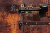 Rusty gate with lock — Stock Photo