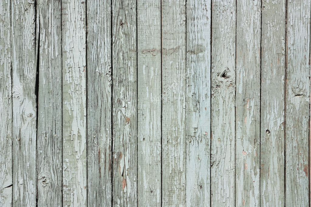 A fragment of an old,  painted, wooden fence  Stock Photo #3303491