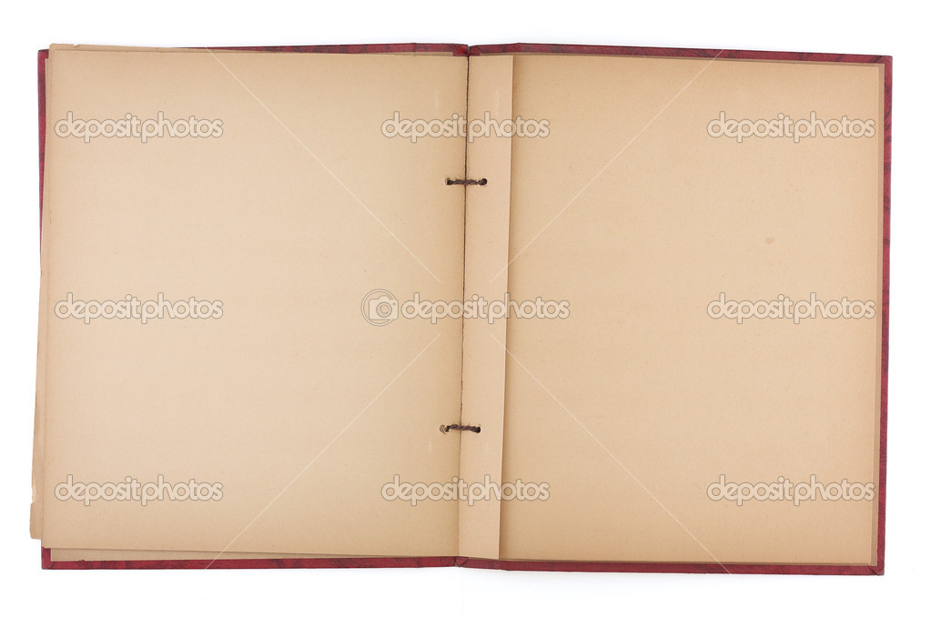 An old scrap book, open to reveal yellowing blank pages. — Stock Photo #3504035